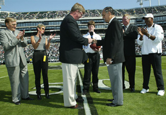 Casper receives ring on Oct. 20, 2002.  (Photo:  Mickey Elliot/Oakland Raiders)